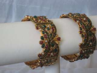 NEW RUBY AND EMERALD BANGLE SET IN18 KARAT GOLD PLATED